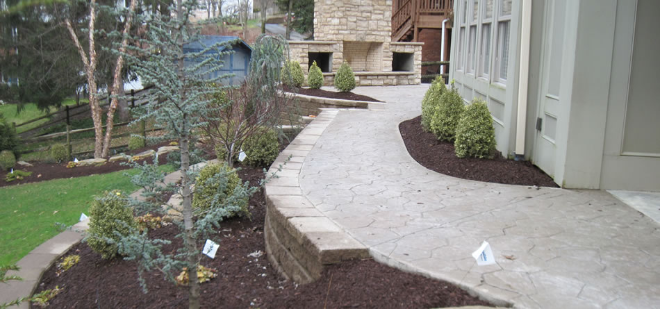 Concrete Patio, fireplace, Tiered Retaining Walls